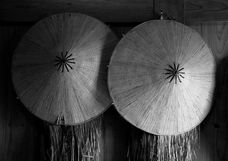 Close-Up Of Asian Style Conical Hats On Wall