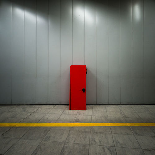 Red Locker Against Gray Wall