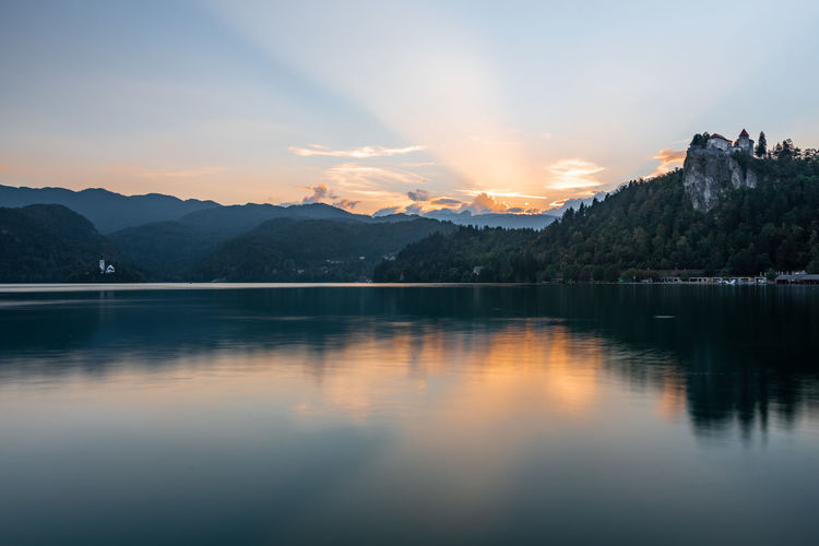Sky Water Scenics - Nature Mountain Beauty In Nature Reflection Tranquility Tranquil Scene Cloud - Sky Sunset Lake Nature Waterfront Mountain Range Idyllic No People Non-urban Scene Outdoors Dusk