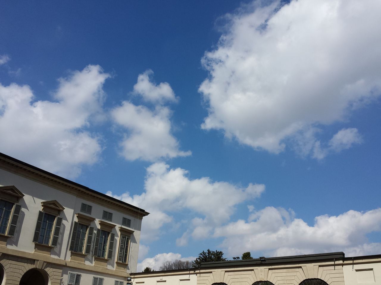 architecture, cloud - sky, building exterior, sky, built structure, low angle view, day, no people, outdoors, blue
