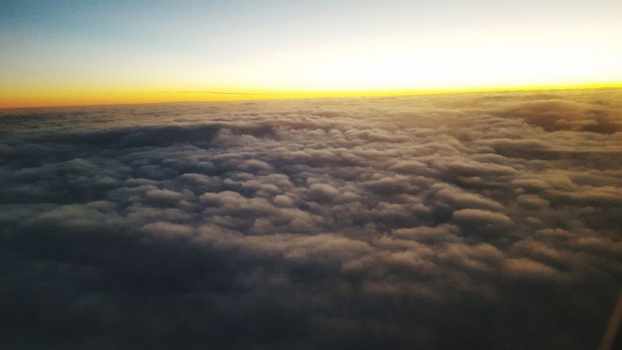 up in the clouds Airplane Sunset Planet Earth Space Aerial View Gold Colored Sky Landscape Cloud - Sky Sky Only Plane Dramatic Sky Heaven Cumulus Cloud Cumulonimbus Cloudscape Fluffy Cumulus Meteorology
