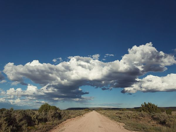 """""""The Horizontal Pillar Of Cloud"""" """"Neither the pillar of cloud by day nor the pillar of fire by night left its place in front of the people."""" Exodus 13:22 New Mexico Photography New Mexico New Mexico Skies Country Road Dirt Road vanishing point Clouds And Sky Cloudscape Clouds Sky Cloud - Sky Scenics - Nature Beauty In Nature Tranquility Tranquil Scene Nature Landscape The Way Forward"""