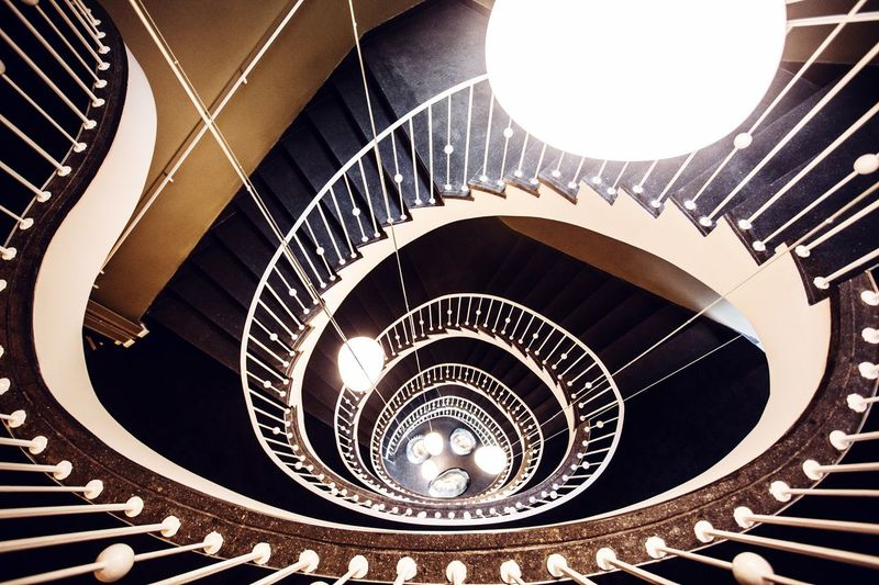 Stairs Staircase Spiral Steps And Staircases Architecture Spiral Staircase Built Structure Railing Pattern Indoors  No People High Angle View Design Directly Above Diminishing Perspective Day Shape Building Close-up Directly Below Concentric