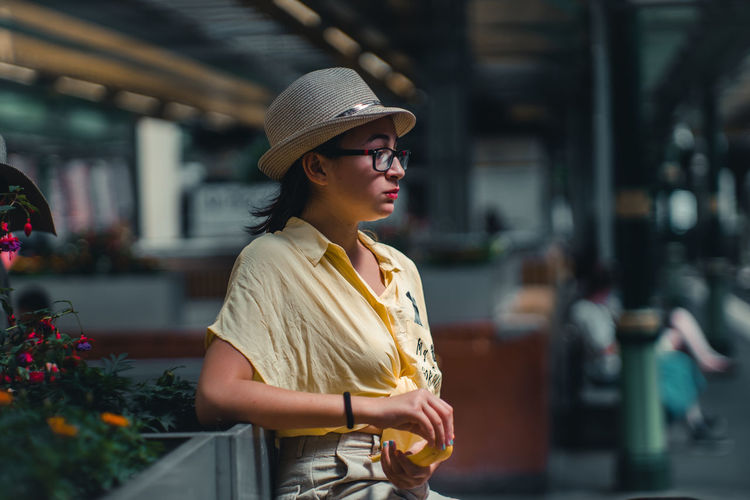 Young Woman Wearing Eyeglasses Looking Away