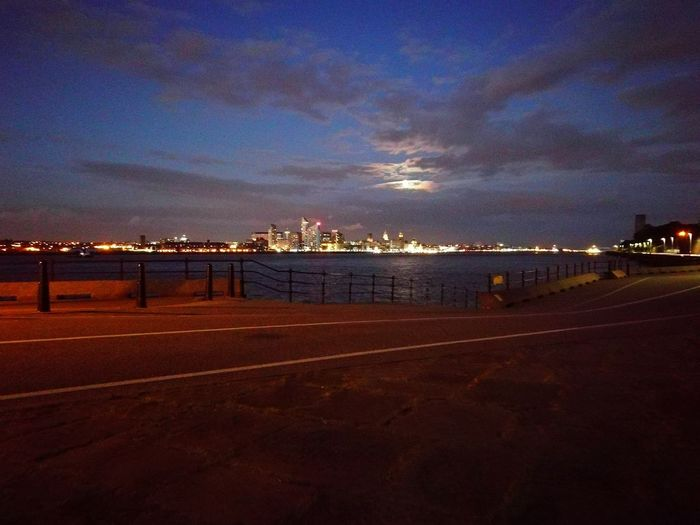 Liverpool Waterfront taken from Egremont Promenade by The Ferry Pub in Moonlight Across The River River Mersey