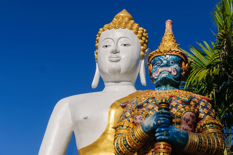 Sculpture Religion Representation Belief Statue Human Representation Spirituality Male Likeness Art And Craft Creativity Low Angle View No People Sky Place Of Worship Blue Built Structure Architecture Gold Colored Idol