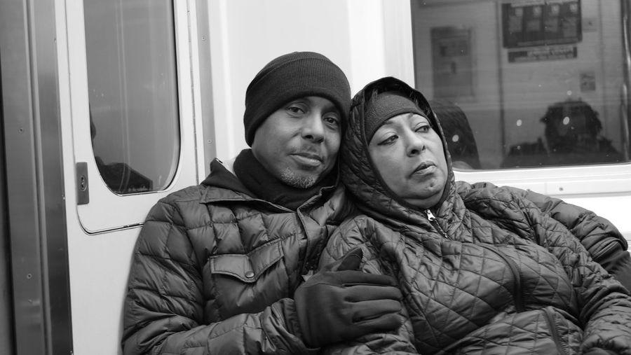 Portrait of couple in warm cloths boarding on metro train
