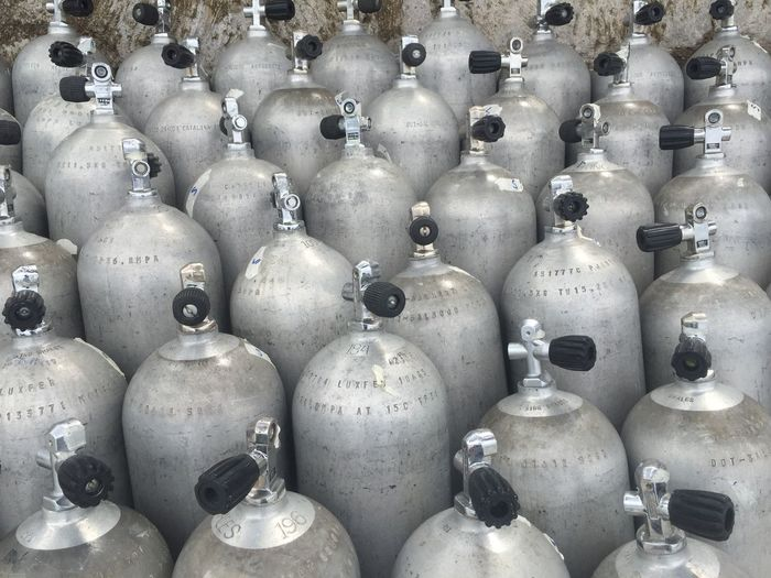 Full frame shot of gas cylinders in factory