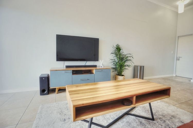 Coffee table with tv in background