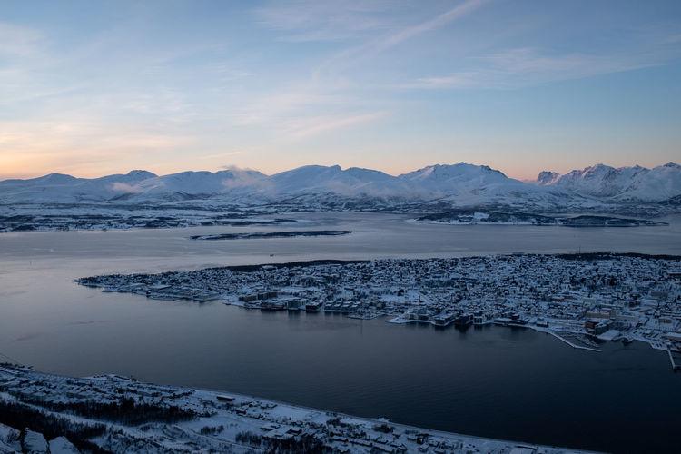 Tromsøysundet tromsø norway landscape  with mountainous background in winter.