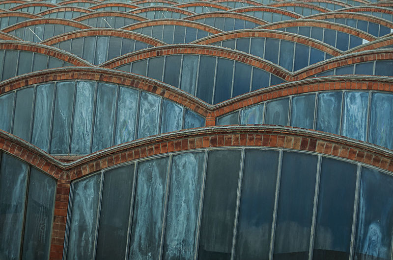 modernist factory roof with glass Architecture Catalunya Curve Industry Red Rooftop SPAIN Terrassa Abstract Arch Blue Brick Building Exterior Built Structure Day Glass Historic Minimalism Modernism No People Old Outdoors Pattern Textile Window The Graphic City