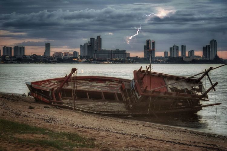 lighting (double exposure) City Cityscape Urban Skyline Nautical Vessel Skyscraper Business Finance And Industry Downtown District Ship Beach Water Thunderstorm Storm Cloud Storm Extreme Weather Dramatic Sky