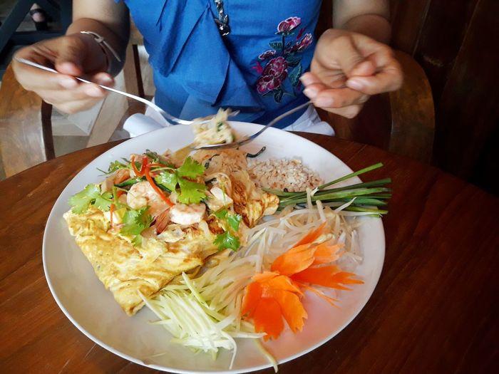 High angle view of man having food on table