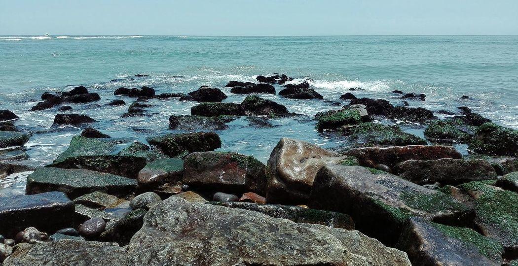 Beach Sand Rocks Moss Ocean SeaShore Mare Sky Showcase March Water Saltwater Natural Beauty Natural Beauty Texture Surface Waves Calm Light Sun Wet Stones Foam First Eyeem Photo