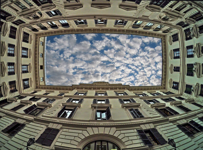 Window Built Structure Built Structure Architecture Exterior Cloud - Sky Roma Hello World Taking Photos EyeEm Best Shots Courtyards Low Angle View Sky Day Building Residential Structure Fish-eye Lens Historic Office Building Skylight Distorted Image