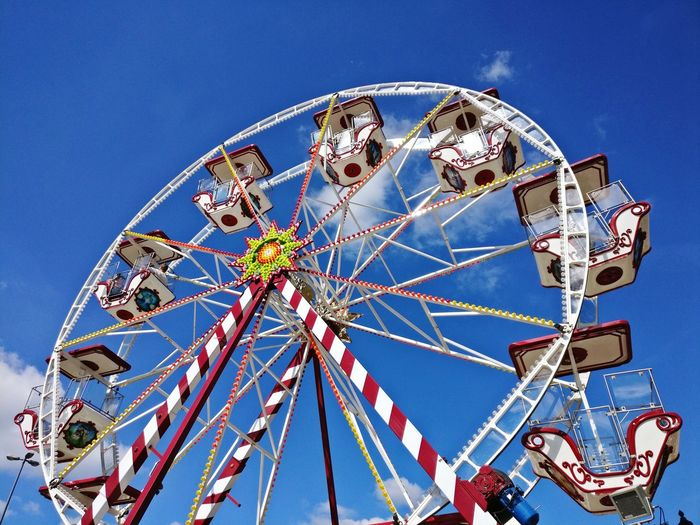 Ferris wheel in front of a blue sky EyeEm Selects Ferris Wheel Amusement Park Ride Arts Culture And Entertainment Clear Sky Amusement Park Traveling Carnival Blue Big Wheel Sky Close-up Fairground Fairground Ride Merry-go-round EyeEmNewHere