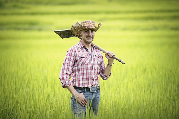 Full length of senior woman standing in farm