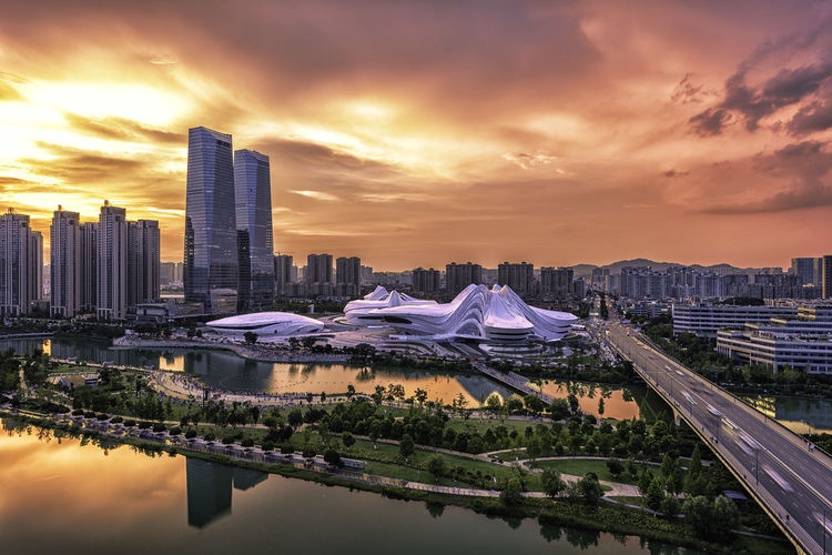Meixi Lake 0728 Changsha Theater Architecture Building Building Exterior Built Structure China City Cityscape Cloud - Sky Financial District  Modern Nature No People Office Building Exterior Operahouse Outdoors Reflection Sky Skyscraper Sunset Tall - High Travel Destinations Water