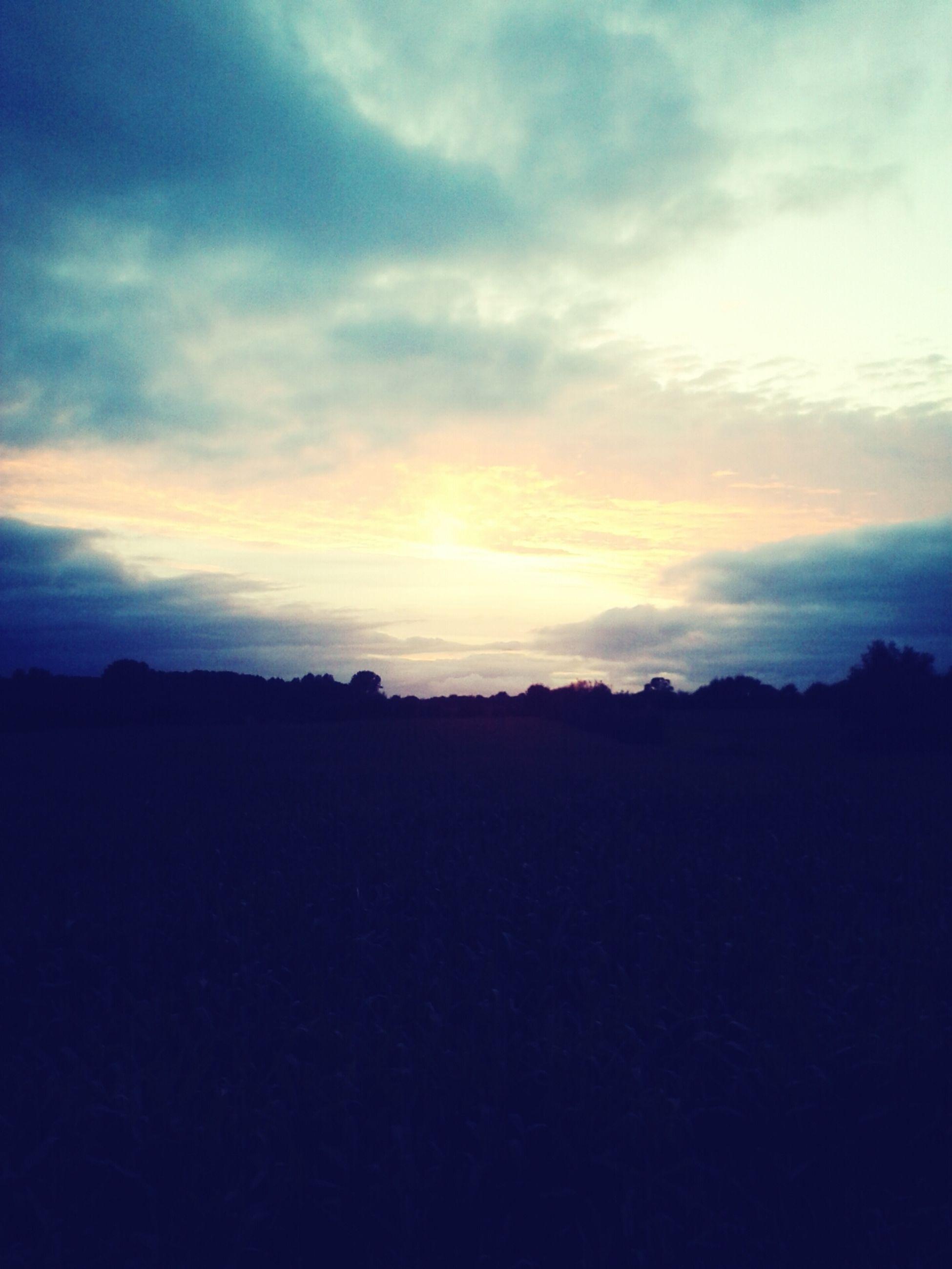 silhouette, sunset, tranquil scene, scenics, sky, tranquility, beauty in nature, landscape, cloud - sky, nature, idyllic, dark, cloud, dusk, outline, copy space, orange color, outdoors, non-urban scene, horizon over land