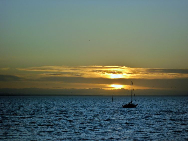 Sun setting into lonely blues. Seaside Seascape Southend On Sea Sea And Sky British Seaside Sunset Sea View Loneliness Sea Lonely Tranquility Southend Boat Boats Beauty In Nature Serenity
