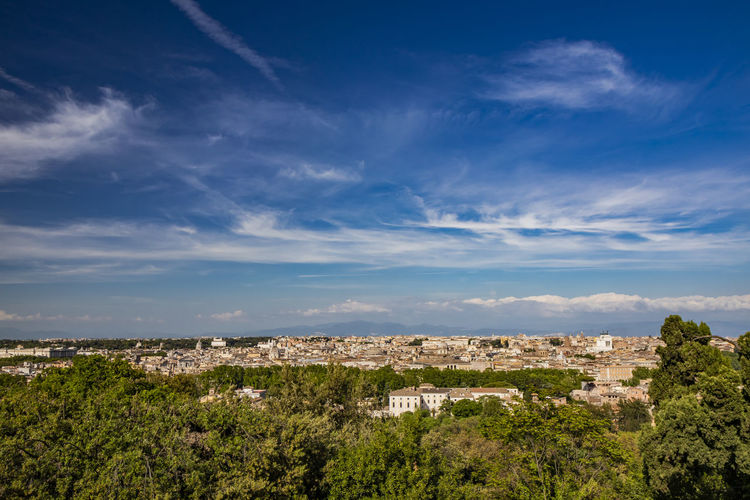 Panoramic view of city and buildings against sky
