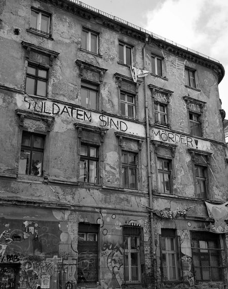 Berlin German Germany No People Day Building Exterior Architecture Built Structure Window Low Angle View Residential Building Ww2 Cold War Peace Rebellious Youth Text Meaningful  Black And White Photography Black&white Soldier Murder Architecture Streetart Graffiti Building