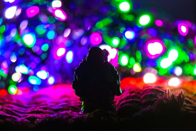 Illuminated Night Lighting Equipment Multi Colored One Person Glowing Decoration Light Christmas Lights Silhouette Close-up Focus On Foreground Christmas Selective Focus Indoors  Light - Natural Phenomenon Electric Light Celebration Christmas Decoration Purple