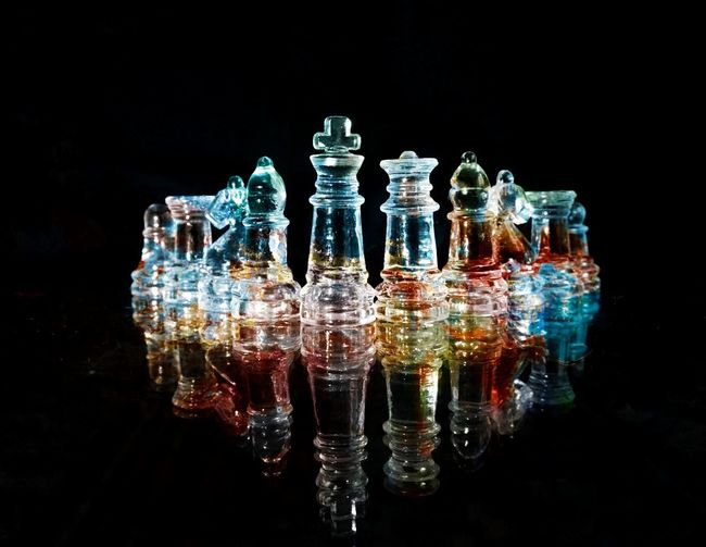 Black Background Studio Shot Indoors  Glass - Material Reflection Transparent Strategy No People Game Board Game Chess Choice Still Life Variation Multi Colored Large Group Of Objects Close-up Blue Nature Challenge Queen - Chess Piece King - Chess Piece Pawn - Chess Piece