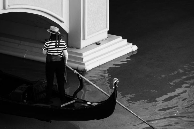 Real People Nautical Vessel Building Exterior One Person Architecture Outdoors Day Full Length Built Structure Men Oar Gondolier Gondola - Traditional Boat Canal Canals And Waterways Venice Venetian Water Mode Of Transport Blackandwhite Monochrome Women Around The World