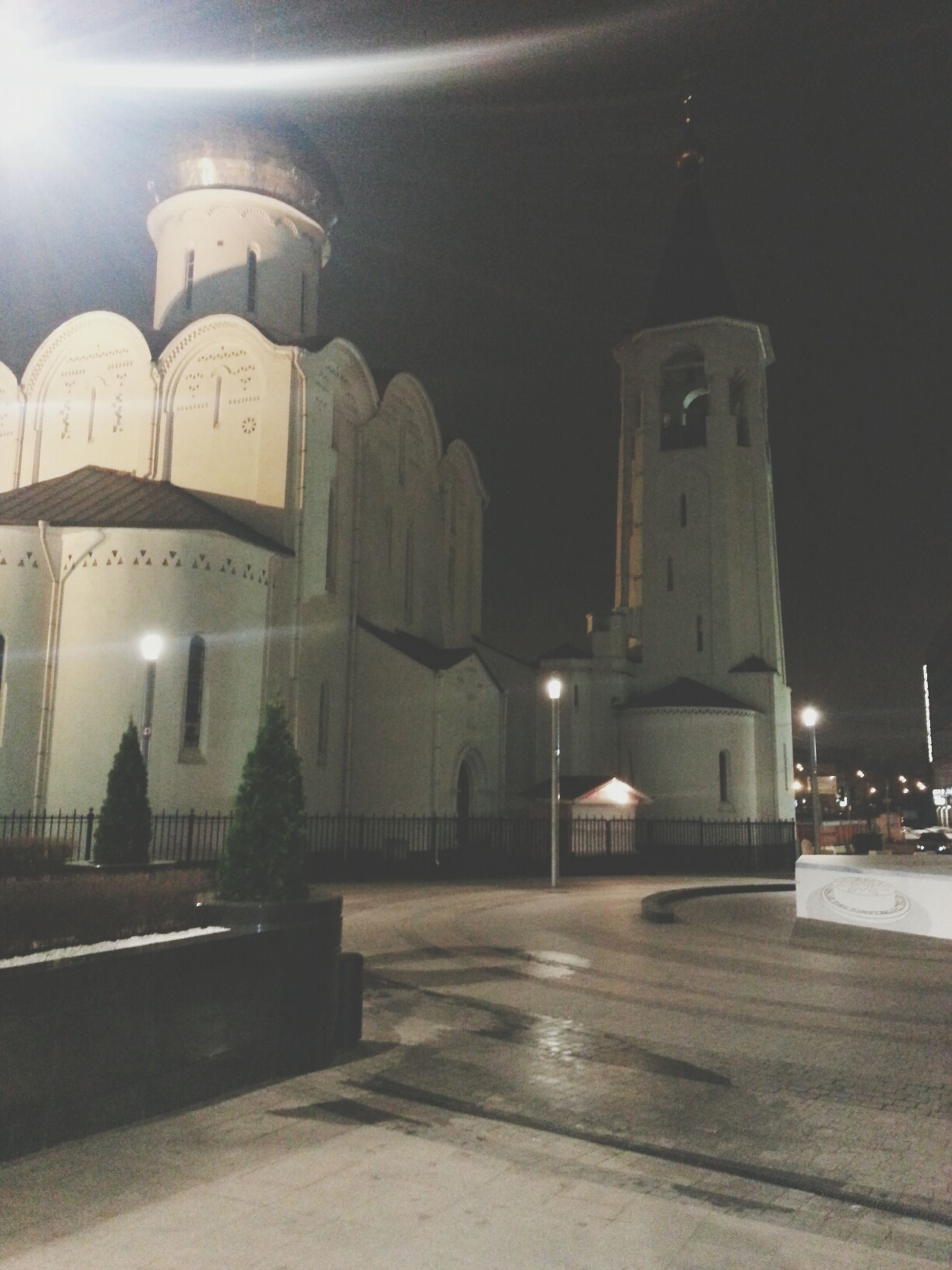 architecture, built structure, illuminated, night, building exterior, church, religion, lighting equipment, street light, place of worship, spirituality, clear sky, dome, road, street, travel destinations, city, the way forward