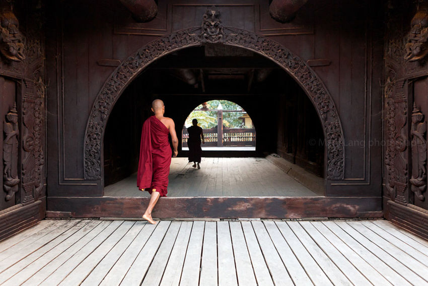 Buddhist monks in a wooden monastery of Mandalay, Myanmar. Arch Architecture Buddhism Buddhist Buddhist Monks Built Structure Burma Burmese Corridor Day Diminishing Perspective Mandalay Monastery Monks Myanmar Temple The Way Forward Travel Travel Destinations Vanishing Point Walking Walkway Wood Wooden Wooden Temple
