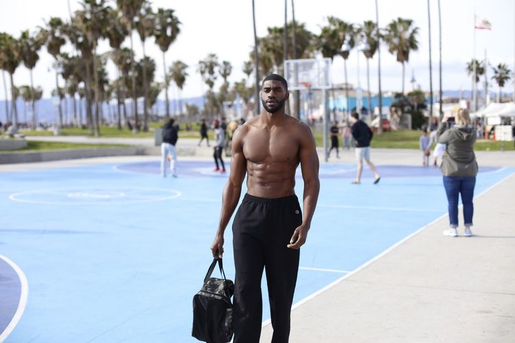EyeEm Selects Lifestyles Real People Sport Young Adult Young Men Men Tree Strength One Person Healthy Lifestyle Shirtless Adult Exercising Walking Three Quarter Length Incidental People Day Athlete Nature Shorts