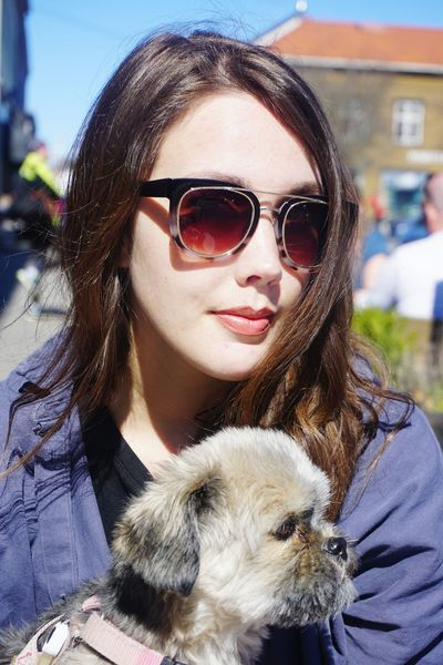 Young woman and her dog at outdoor cafe Woman Longhair Beautiful Beautiful Woman Spring Summer Dog Pet Cafe City Friends Sunglasses Warm Clothing Young Women Pets Portrait Smiling Happiness Beautiful Woman Dog Women Looking At Camera Red Lipstick Lipstick