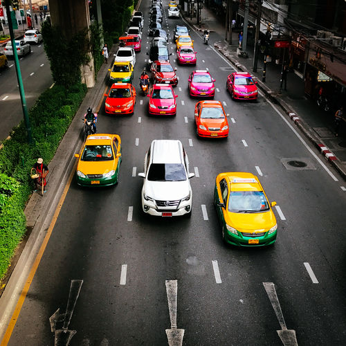 Colorful taxis in Bangkok Transportation Mode Of Transportation Car Road City Motor Vehicle Street Land Vehicle Traffic Architecture High Angle View Incidental People Marking Road Marking City Street City Life Motion Symbol Sign on the move Taxi Taxis Colors Colorful