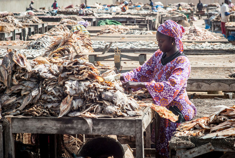 Woman with fish for sale at market