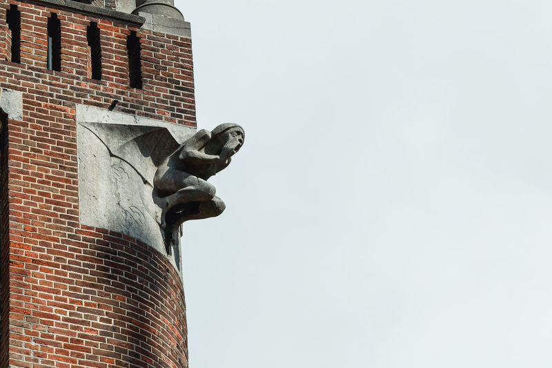 Amsterdam Chimera Animal Themes Architecture Building Exterior Built Structure Copy Space Day Europe Low Angle View Mammal No People Outdoors Perching Roof Sculpture Sky Statue