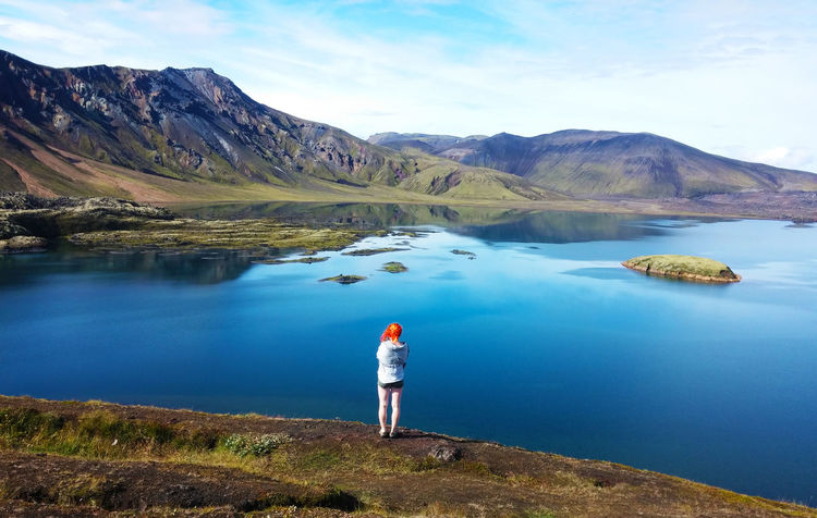 Alone Iceland Red Woman Wonderful Beauty In Nature Beauty In Nature Bestoftheday Blue Cloud - Sky Lake Nature One Person Real People Silence Sky Tranquil Scene Tranquility Water
