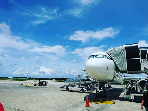 Touchdown! Airplane Air Vehicle Airport Runway Airport Outdoors Day Travel Architecture Mobile Photography Sky Flight ✈ Arrival Departure Board Aerospace Industry