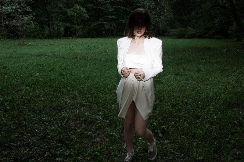 Full length of woman standing on grass