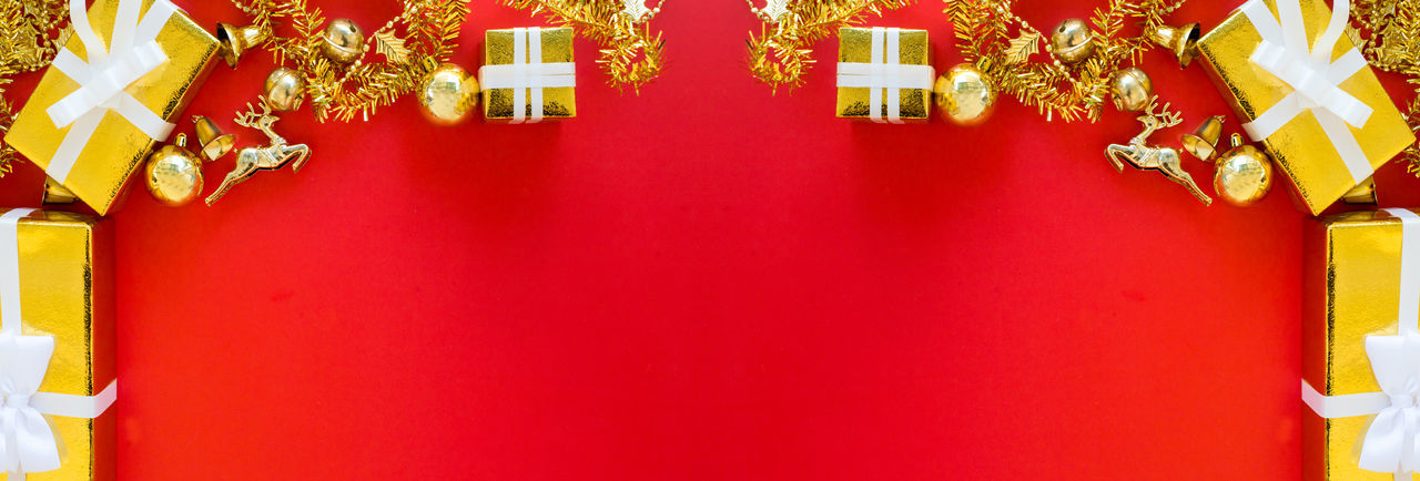 Close-up of red decoration hanging on wall