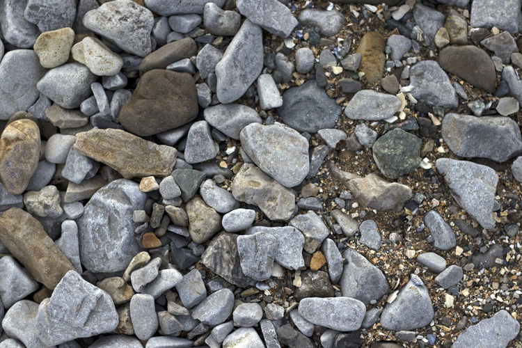 Solid Stone - Object Rock Stone Rock - Object No People Nature Pebble Textured  Large Group Of Objects High Angle View Backgrounds Gray Day Full Frame Outdoors Abundance Rough Pattern Directly Above Gravel Textured Effect