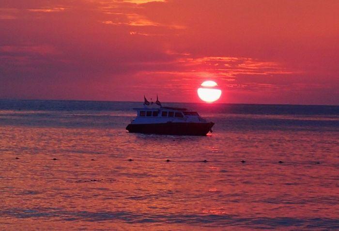 Red sunset Horizon Over Water Nature Outdoors Scenics - Nature Sea Sunset Sunset #sun #clouds #skylovers #sky #nature #beautifulinnature #naturalbeauty #photography #landscape Tranquil Scene