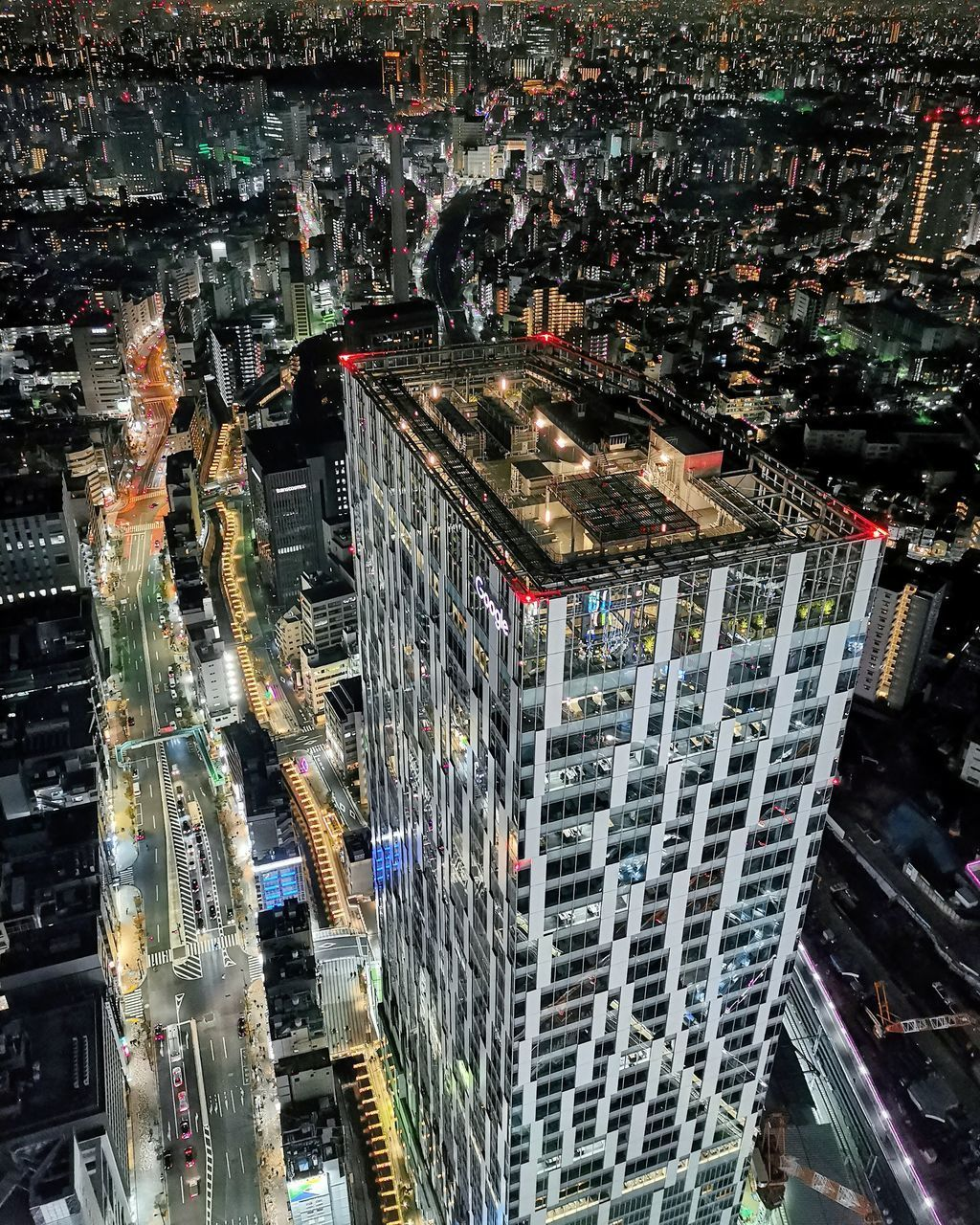 AERIAL VIEW OF ILLUMINATED CITY BUILDINGS