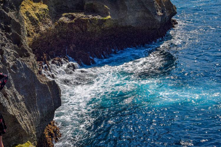 Sea waves splashing on rock
