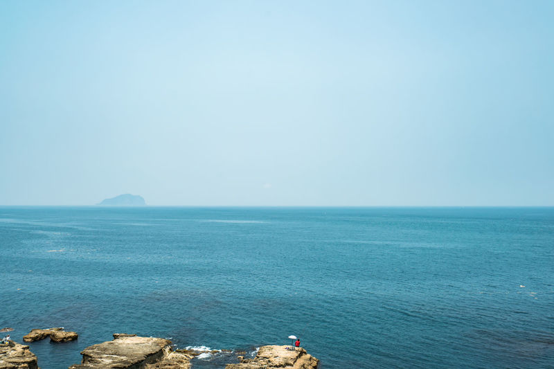 Sea Scenics - Nature Horizon Over Water Water Sky Horizon Beauty In Nature Tranquil Scene Tranquility Copy Space Clear Sky Blue Day Idyllic Nature Non-urban Scene Rock Land No People Outdoors