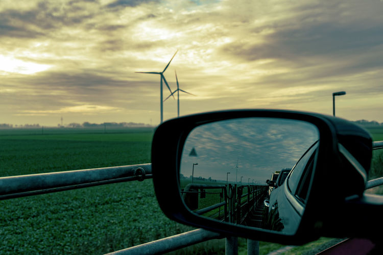 Reflection Alternative Energy Car Close-up Cloud - Sky Day Field Grass Landscape Maserati Quatroporte Mirror Motorail Nature No People Northsea Outdoors Rear-view Mirrors Road Rural Scene Side-view Mirror Sky Sunset Sylt, Germany Transportation Windmills