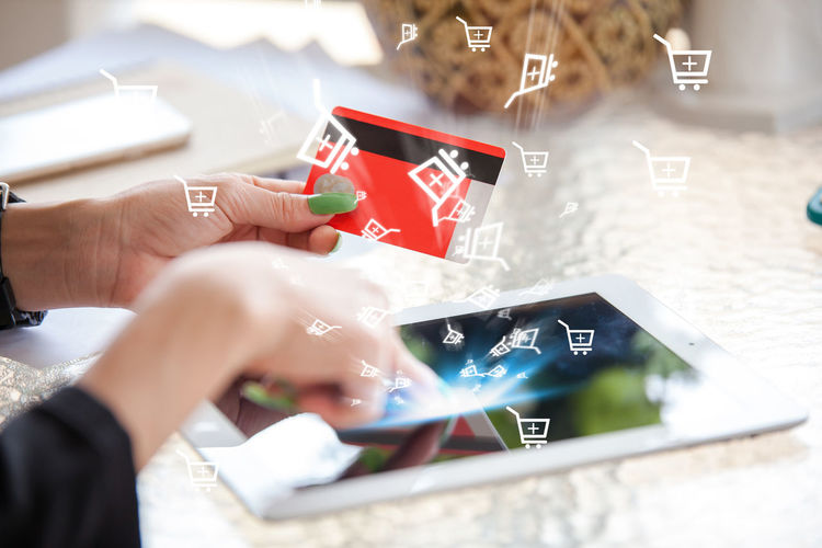 Digital composite image of person by various icons doing online shopping