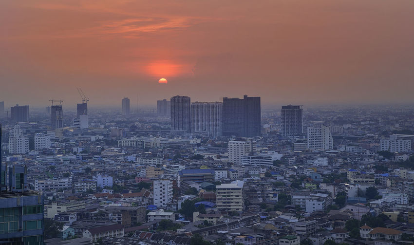 sun set in the city Building Exterior Sky Architecture Built Structure City Sunset Building Cityscape Crowd Residential District Sun Crowded Nature Office Building Exterior Skyscraper Orange Color Cloud - Sky High Angle View Outdoors Romantic Sky
