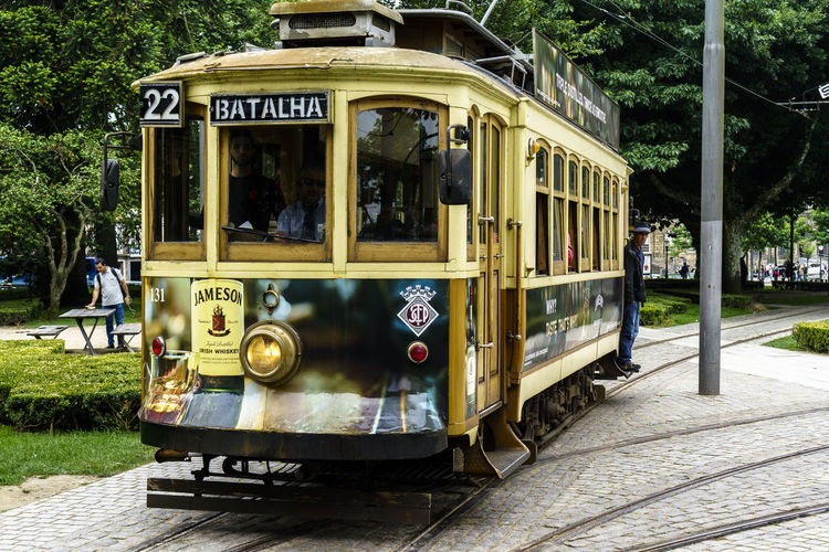 City City Life Streetphotography Tramway Tramway Rail Mode Of Transportation Transportation Land Vehicle Public Transportation Cable Car Railroad Track Rail Transportation Day Track Incidental People Plant Outdoors Architecture Tree Train Travel Street Train - Vehicle Bus School Bus
