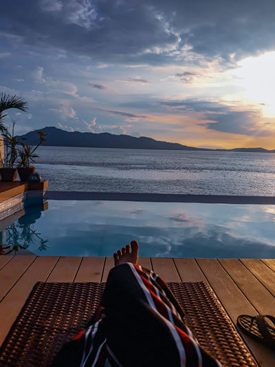 Sunset Sea Ocean Ocean View Seascape Water Sea Sunset Relaxation Beach Mountain Sky Countryside Swimming Pool Poolside Horizon Over Water Sun Lounger Lounge Chair Deck Chair Pool Resort Swimming Lane Marker Infinity Pool Seascape Calm Standing Water Shore Tranquil Scene Star Field Pool Party A New Beginning EyeEmNewHere